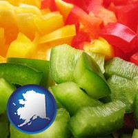 alaska map icon and sliced and diced green, red, and yellow peppers