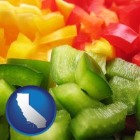 ca map icon and sliced and diced green, red, and yellow peppers