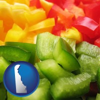 de map icon and sliced and diced green, red, and yellow peppers