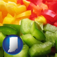 in map icon and sliced and diced green, red, and yellow peppers