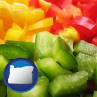 or map icon and sliced and diced green, red, and yellow peppers