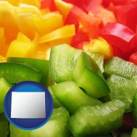 wy map icon and sliced and diced green, red, and yellow peppers