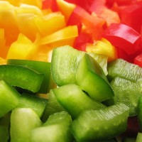 sliced and diced green, red, and yellow peppers